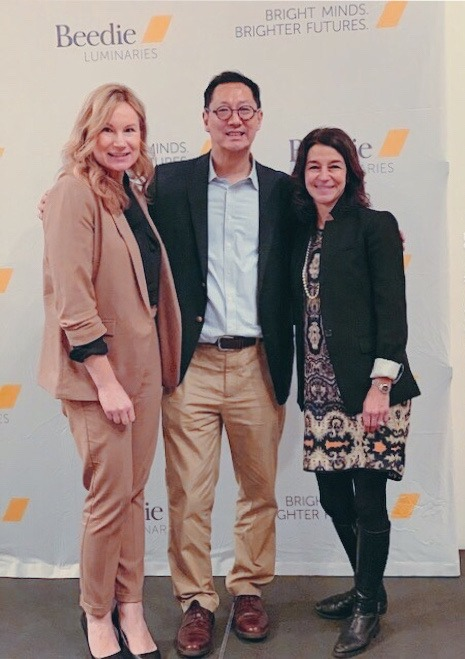 Melinda Giampietro, President and Founder of Options Solutions; Martina Meckova, Beedie Executive Director; and Santa Ono, UBC President pose for a photo to celebrate the Beedie Luminaries